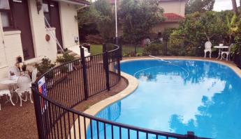 black metal fencing around swimming pool