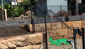 Tubular security fencing around a pool area