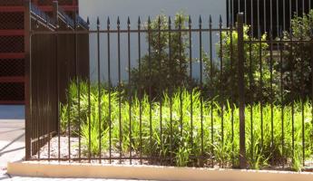 dark security fencing around property