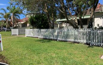 White tubular security fencing